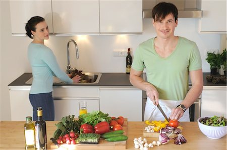 fungus - Young couple in kitchen preparing salad Stock Photo - Premium Royalty-Free, Code: 689-05612001
