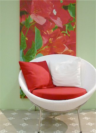 red chair - White armchair and picture of a flower Stock Photo - Premium Royalty-Free, Code: 689-05612188