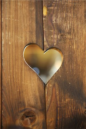 Heart-shaped hole in wooden boards Stock Photo - Premium Royalty-Free, Code: 689-05612259