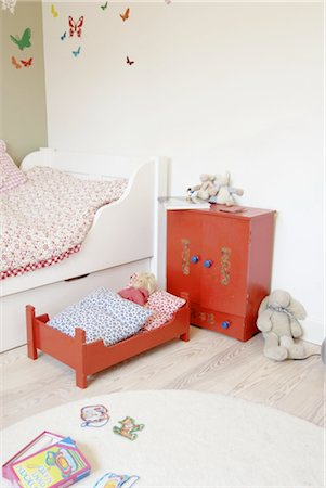 Childrens room with dolls bed Stock Photo - Premium Royalty-Free, Code: 689-05612339