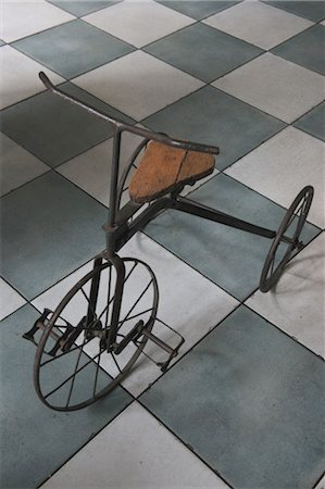 Antique tricycle on tiled floor Stock Photo - Premium Royalty-Free, Code: 689-05612463