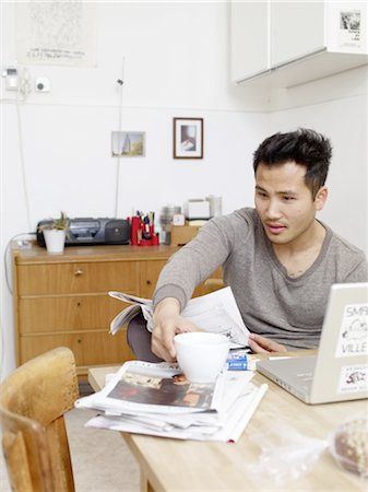 Man reading newspaper at home Stock Photo - Premium Royalty-Free, Code: 689-05612537