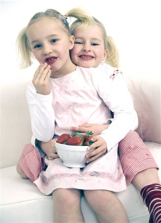 Two girls with bowl of strawberries Stock Photo - Premium Royalty-Free, Code: 689-05612580