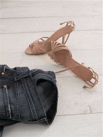Jeans and womens shoes on wooden floor Stock Photo - Premium Royalty-Free, Code: 689-05612635