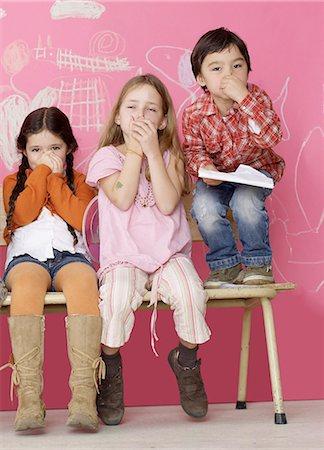 smelly - Three children keeping their noses shut Stock Photo - Premium Royalty-Free, Code: 689-03129454