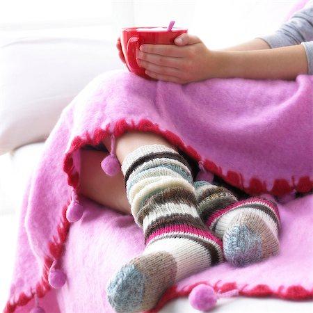 stocking feet - warm afternoon on the sofa Stock Photo - Premium Royalty-Free, Code: 689-03123872