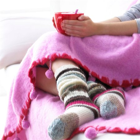 stocking feet - warm afternoon on the sofa Stock Photo - Premium Royalty-Free, Code: 689-03123872