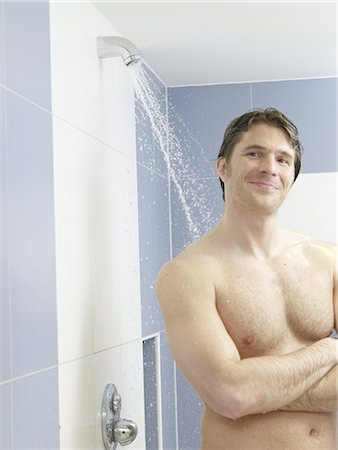 Man in the shower Stock Photo - Premium Royalty-Free, Code: 689-03130554