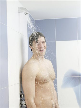 Man in the shower Stock Photo - Premium Royalty-Free, Code: 689-03130556