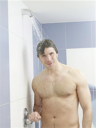 Man in the shower Stock Photo - Premium Royalty-Free, Code: 689-03130557