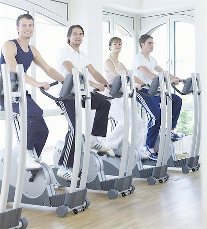 rehabilitation - young people on fitness bikes Stock Photo - Premium Royalty-Free, Code: 689-03130607