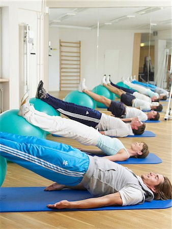 rehabilitation - gymnastic exercise for the back on gym balls Stock Photo - Premium Royalty-Free, Code: 689-03131210