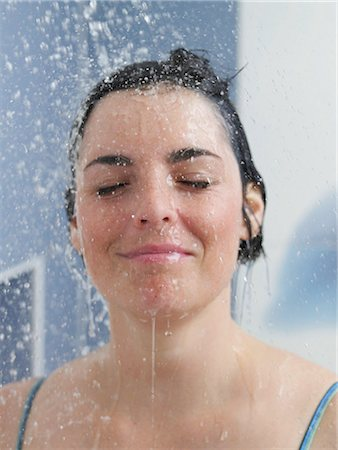 young woman in the shower Stock Photo - Premium Royalty-Free, Code: 689-03131211