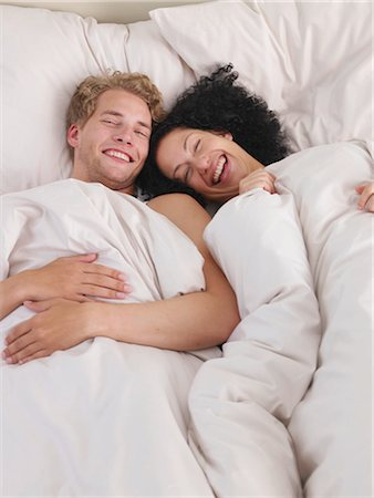 young couple in bed Stock Photo - Premium Royalty-Free, Code: 689-03131265