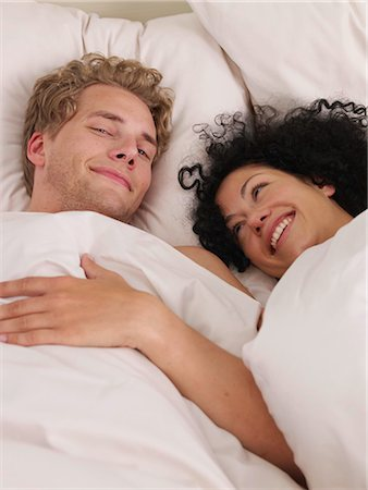 young couple in bed Stock Photo - Premium Royalty-Free, Code: 689-03131268