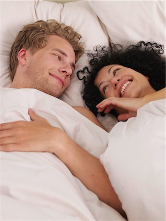 young couple in bed Stock Photo - Premium Royalty-Free, Code: 689-03131270
