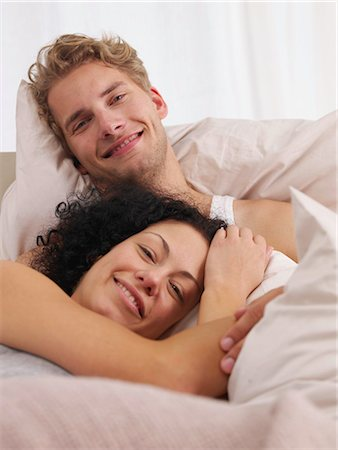 happy couple in bed Stock Photo - Premium Royalty-Free, Code: 689-03131285