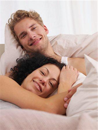 happy couple in bed Stock Photo - Premium Royalty-Free, Code: 689-03131285