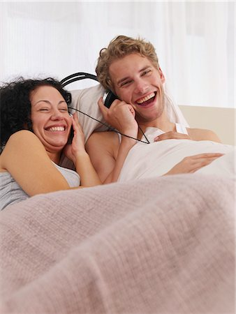 happy couple in bed Stock Photo - Premium Royalty-Free, Code: 689-03131288