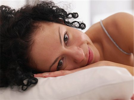 Lounging in bed Stock Photo - Premium Royalty-Free, Code: 689-03131302