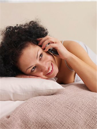 talking on the phone in bed Stock Photo - Premium Royalty-Free, Code: 689-03131324