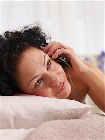 talking on the phone in bed Stock Photo - Premium Royalty-Free, Code: 689-03131335