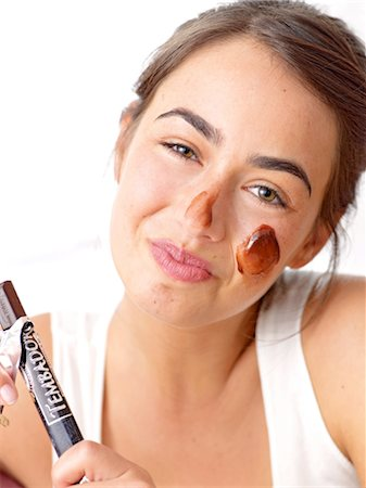 personal care - Brunette woman with a chocolate mask Stock Photo - Premium Royalty-Free, Code: 689-03733003