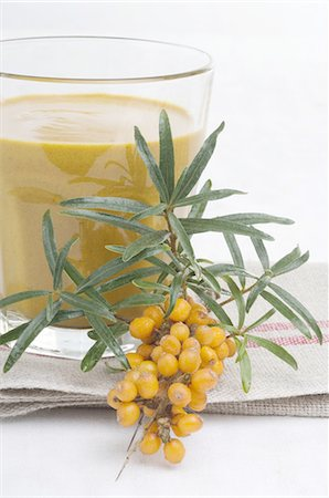 Sea buckthorn branch and juice Stock Photo - Premium Royalty-Free, Code: 689-03733140