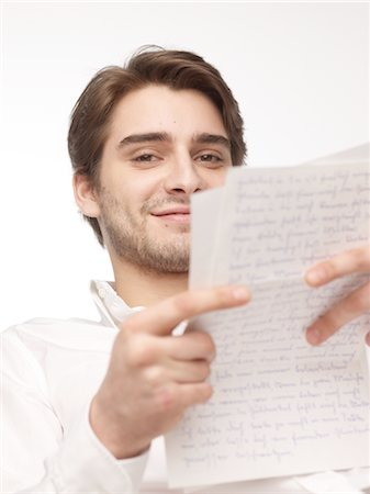 Man reading letter Stock Photo - Premium Royalty-Free, Code: 689-03733189