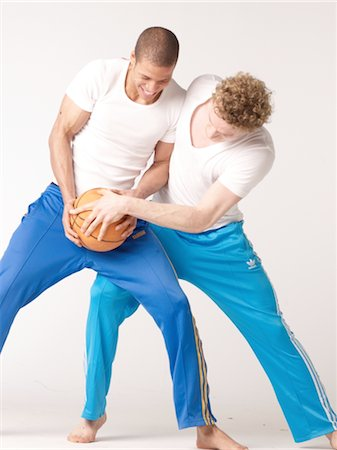 Two friends playing basketball Stock Photo - Premium Royalty-Free, Code: 689-03733191