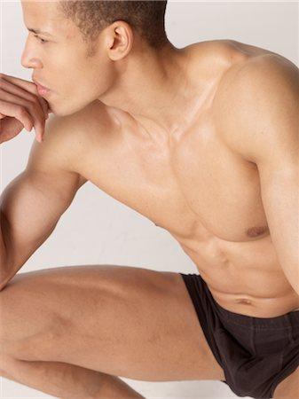 shirtless men - Barechested man thinking Stock Photo - Premium Royalty-Free, Code: 689-03733193