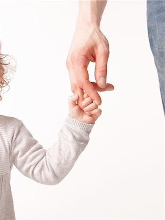 dependable - Father and daughter hand in hand Stock Photo - Premium Royalty-Free, Code: 689-03733277