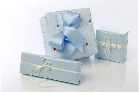 present wrapped close up - Three blue gift boxes Stock Photo - Premium Royalty-Free, Code: 689-03733321