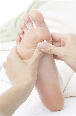 foot massage - Foot zone massage Stock Photo - Premium Royalty-Free, Code: 689-03733333