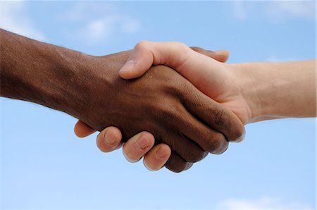 Two men shaking hands Stock Photo - Premium Royalty-Free, Code: 689-03733355