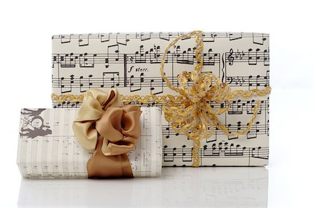 Gift boxes with music sheet imprints Stock Photo - Premium Royalty-Free, Code: 689-03733379