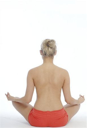 Backless woman in lotus position Stock Photo - Premium Royalty-Free, Code: 689-03733471