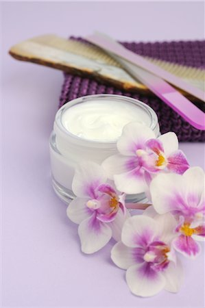 personal care - Cream jars, orchid blossoms and beauty care products Stock Photo - Premium Royalty-Free, Code: 689-03733498