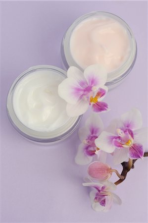 personal care - Cream jars and orchid blossoms Stock Photo - Premium Royalty-Free, Code: 689-03733503