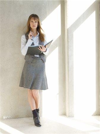 planner - Businesswoman holding scheduler Stock Photo - Premium Royalty-Free, Code: 689-03733681