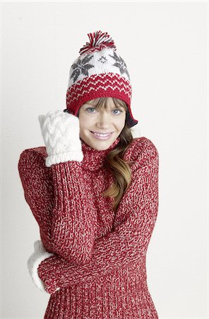 Woman wearing pullover, gloves and wooly hat Stock Photo - Premium Royalty-Free, Code: 689-03733708