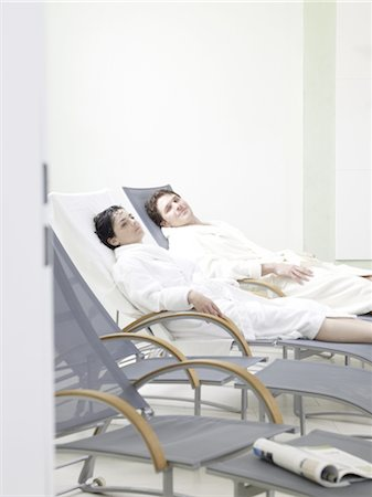 Man and woman lying in deckchairs Stock Photo - Premium Royalty-Free, Code: 689-03733766