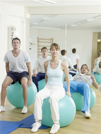 rehabilitation - Three men and a woman exercising with fitness balls Stock Photo - Premium Royalty-Free, Code: 689-03733760