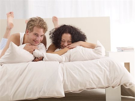 Happy couple in bed Stock Photo - Premium Royalty-Free, Code: 689-03733815