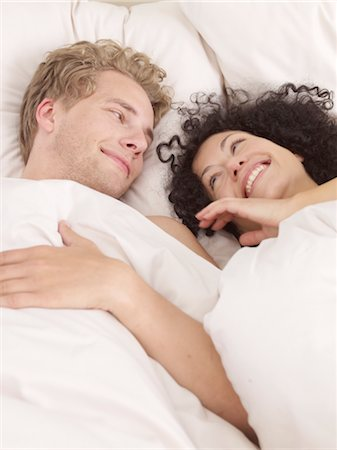 Happy couple in bed Stock Photo - Premium Royalty-Free, Code: 689-03733813