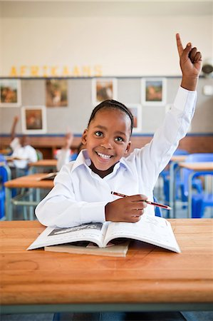 Girl raising hand in classroom, Johannesburg, Gauteng Province, South Africa Stock Photo - Premium Royalty-Free, Code: 682-05649940