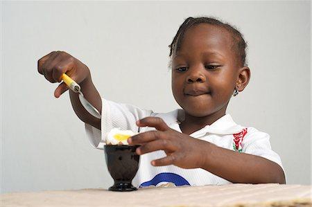 Young Kenyan girl eating boiled egg, Nairobi, Kenya Stock Photo - Premium Royalty-Free, Code: 682-05650119