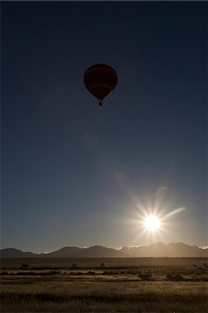 Silhouette of a hot air balloon, near Wellington, Western Cape, South Africa Stock Photo - Premium Royalty-Free, Code: 682-05650152