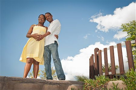 pregnant low angle - Pregnant woman and husband hugging outside, Johannesburg, Gauteng Province, South Africa Stock Photo - Premium Royalty-Free, Code: 682-05650284