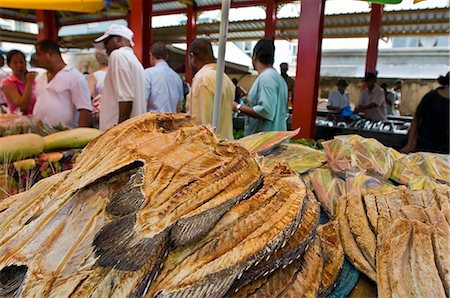 seychelles - Fresh fish market filled with customers and days catch, dried and salted fish for sale, Mahe, Seychelles Stock Photo - Premium Royalty-Free, Code: 682-05650534